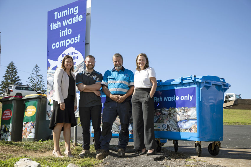 Standing next to one of the blue fish waste bins at Bermagui's harbour are Bega Valley Shire Mayor Kristy McBain, Ocean2earth founders Kyran and Tim Crane and council's acting waste services manager Joley Vidau